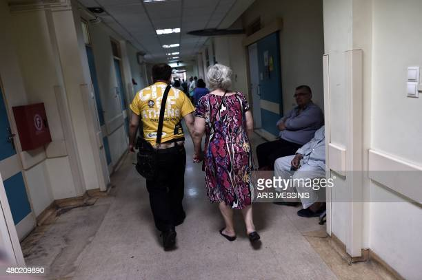 People walk in the corridor of an Athens hospital on July 8 2015 With expectations of a Greek exit from the eurozone gathering pace health officials...