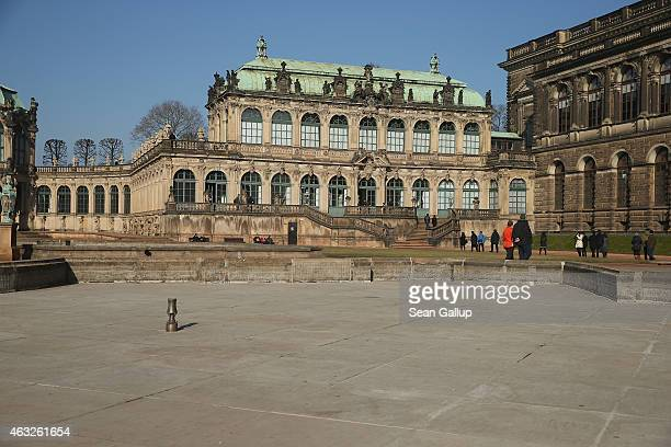 People walk in the courtyard of the Zwinger art museum on February 12 2015 in Dresden Germany The Zwinger as well as the vast majority of the city...