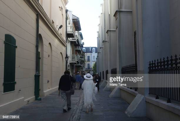People walk in the historic French Quarter the first neighborhood of the city on April 16 2018 in New Orleans Louisiana New Orleans originally...