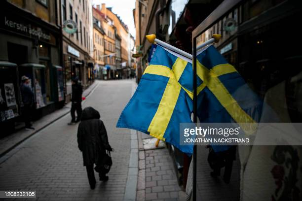 People walk in the main street of the old town in Stockholm Sweden where primary schools restaurants and bars are open and people encouraged to go...