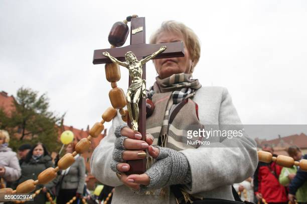 People walk in the March for Life and Family in Krakow Poland on 8 October 2017 The march was organised by conservative Catholic institutions to...