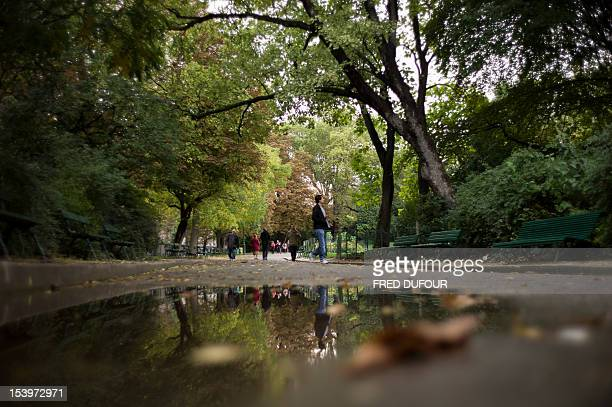 People walk in the Parc des Buttes Chaumont during the fall on October 11 2012 in Paris AFP PHOTO / FRED DUFOUR