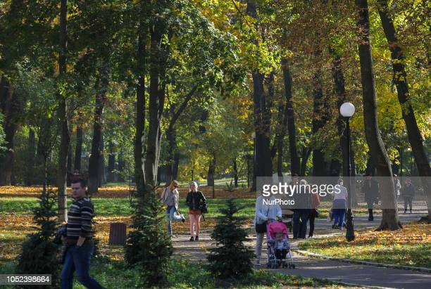 People walk in the park on the sunny day in Kyiv Ukraine October 17 2018 A warm autumn weather came to Ukraine