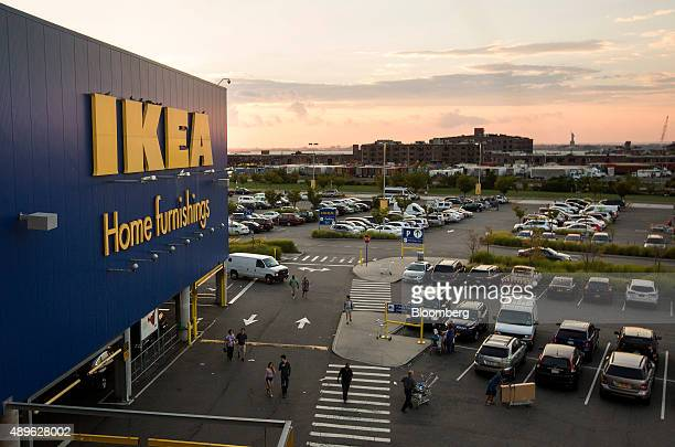 People walk in the parking lot of an Ikea store in the Brooklyn borough of New York US on Saturday Sept 19 2015 The US Census Bureau is scheduled to...