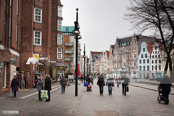 People walk in the pedestrian zone in the city center on March 12 2012 in Rostock Germany Joachim Gauck who will likely be elected by Germany's...