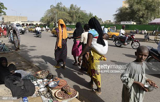 People walk in the street near a market in N'Djamena on March 30 2015 AFP PHOTO / PHILIPPE DESMAZES