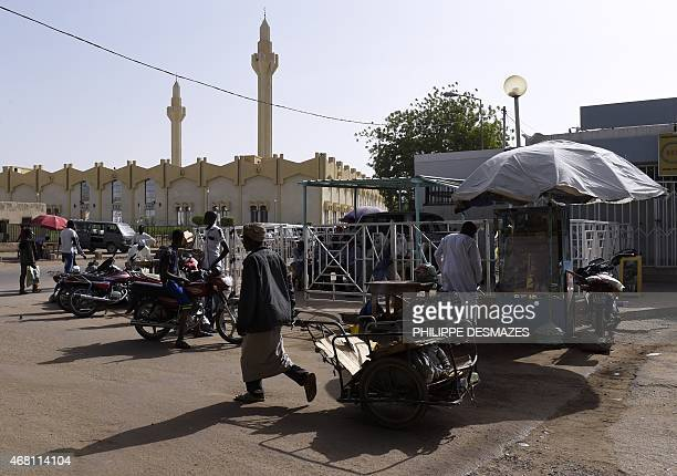 People walk in the street near the Central Mosque of N'Djamena on March 30 2015 AFP PHOTO / PHILIPPE DESMAZES
