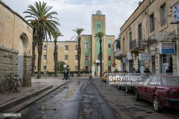 People walk in the streets of the Eritrean capital of Asmara, on July 21, 2018. - Located at over 2000 metres above sea level, the capital of Eritrea...