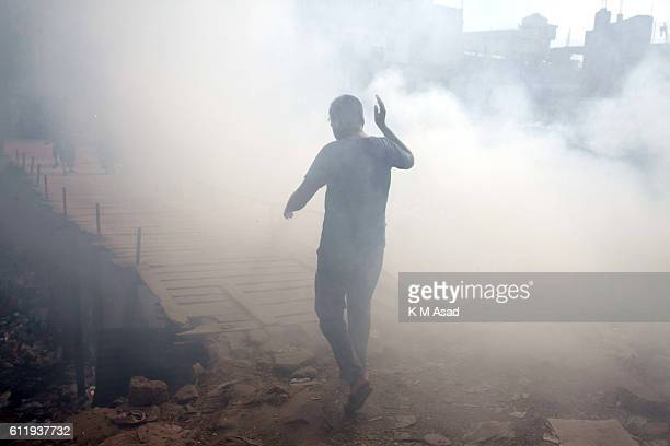 MOHAMMADPUR DHAKA BANGLADESH People walk in the waste burning dumps area producing smoke and toxic pollution at Mohammadpur According to the World...