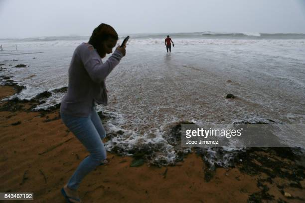 People walk in the water at Luquillo Beach prior to the passing of Hurricane Irma on September 6 2017 in San Juan Puerto Rico The category 5 storm is...