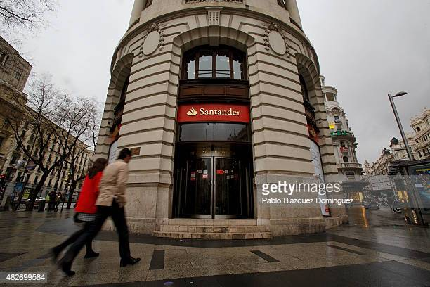 People walk in to a Banco Santander's office on February 2 2015 in Madrid Spain The eurozone's largest bank announced profits rose in all its 10 key...