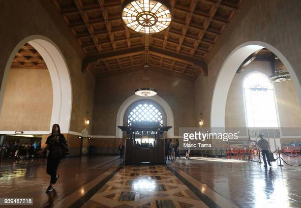 People walk in Union Station a public transit hub on March 28 2018 in Los Angeles California Between 2016 and 2017 public transit ridership fell in...