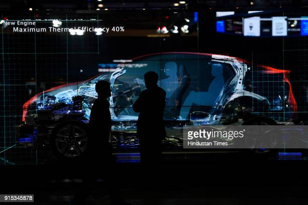 People walk inside a hall during Auto Expo 2018 motor show at the India Expo Mart on February 7 2018 in Greater Noida India The Expo will include two...