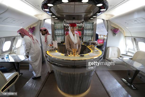 People walk inside of the 100th Emirates Airline doubledecker Airbus A380 the worlds largest passenger aircraft during the 2018 Bahrain International...