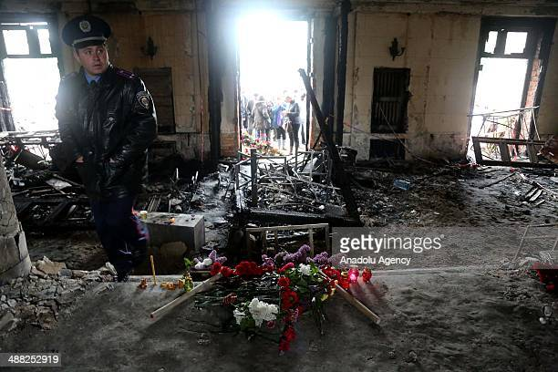 People walk inside the burnt Trade Union building where more than 40 people died in a fire during the recent clashes in the South-Ukrainian city of...