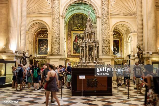 People walk inside the Catedral de Sevilla in Sevilla Spain on September 14 2018