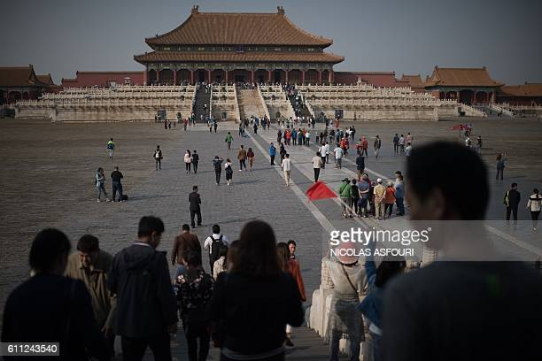 People walk inside the Forbidden City in Beijing on September 29 2016 China celebrates 'Golden Week' on October 1 with a weeklong holiday to...