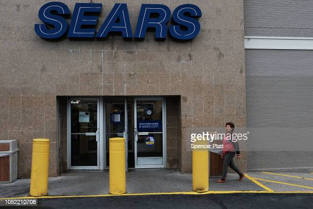 People walk into a Sears store on October 15, 2018 in the Brooklyn borough of New York City. The iconic American retailer has filed for Chapter 11...