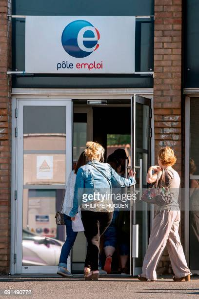 People walk into an employment office on June 2 2017 in Bailleul northern France HUGUEN