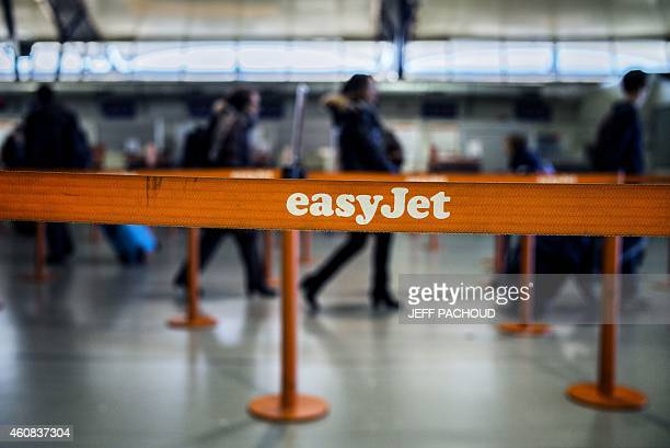 People walk into Easyjet company's wicket on December 26 2014 in SaintExupery airport in Lyon central France Budget airline Easyjet warned its...