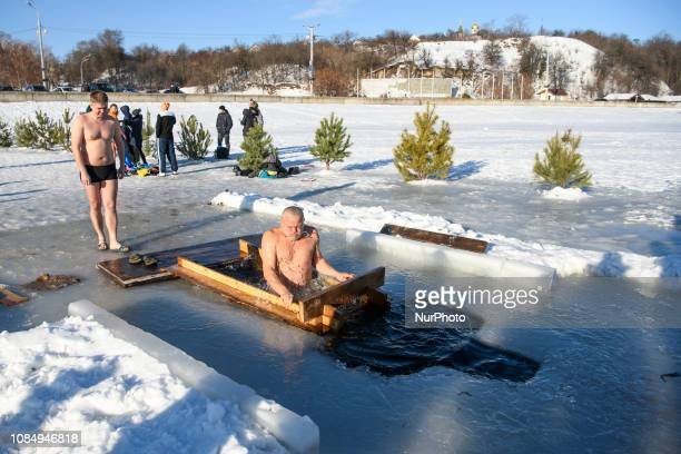 People walk into icy waters to take a dip during celebrations of the Orthodox Christian feast of Epiphany in Vyshgorod city Ukraine January 19 2019