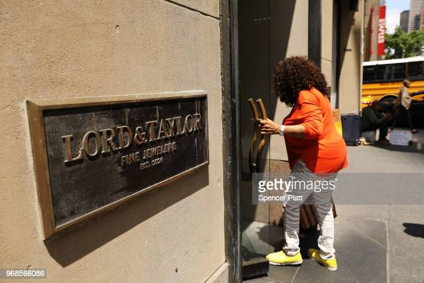 People walk into Lord Taylor's flagship store on 5th Avenue in Manhattan on June 6 2018 in New York City The 192yearold chain owned by Canada's...