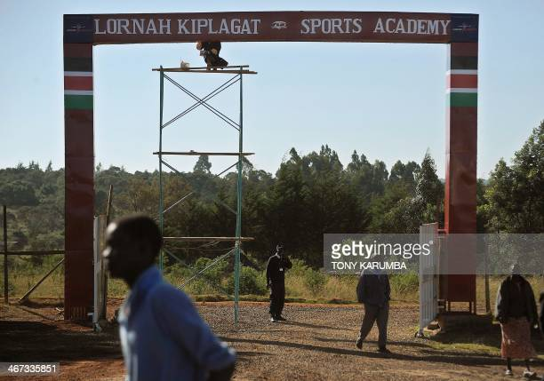People walk into Lorna Kiplagat Sports Academy as work progresses on the arch over the entry to witness the inauguration of the Academy attended by...