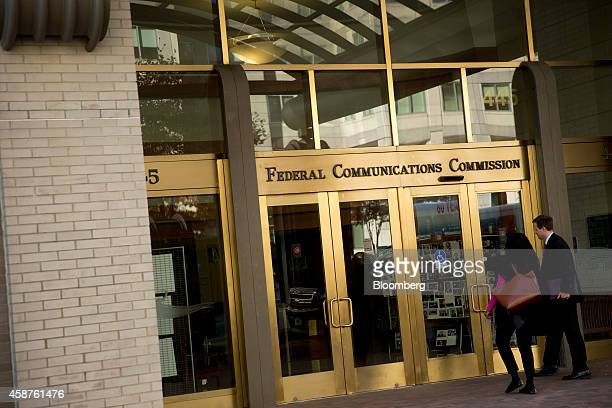 People walk into the Federal Communications Commission headquarters in Washington DC US on Monday Nov 10 2014 President Barack Obama called for the...