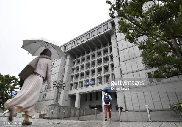People walk into the Osaka city office on Nov. 2 a day after voters opposed reorganizing the western Japan city into a metropolis akin to Tokyo by a...