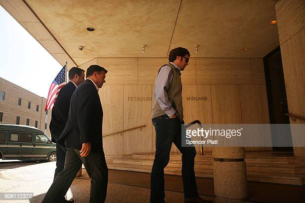 People walk into the Petroleum Club on January 21 2016 in the oil town of Midland Texas Despite recent drops in the price of oil many residents of...