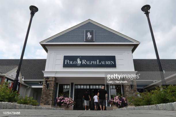 People walk into the Polo Ralph Lauren store at the Woodbury Common Premium Outlets shopping mall on August 26 2018 in Central Valley New York