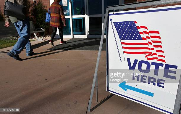 People walk into vote in the presidential election at the Provo Recreation Center on November 8 2016 in Provo Utah Americans across the nation are...