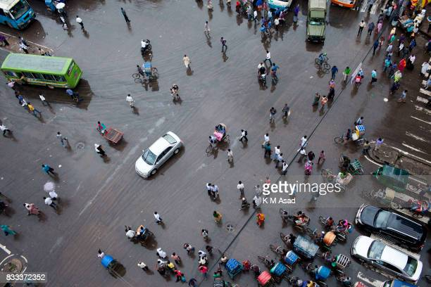 People walk middle in the street at Poltan in the Bangladesh capital Dhaka In the last 10 years the average traffic speed in Dhaka has dropped from...