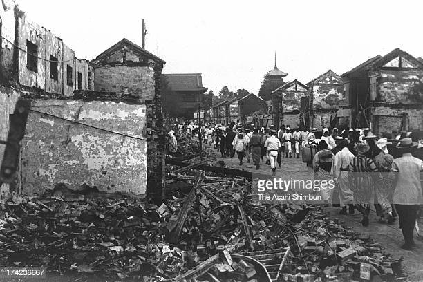 People walk Nakamise street of Asakusa after the Great Kanto Earthquake in September 1923 in Tokyo Japan The estimated Magnitude 79 strong earthquake...