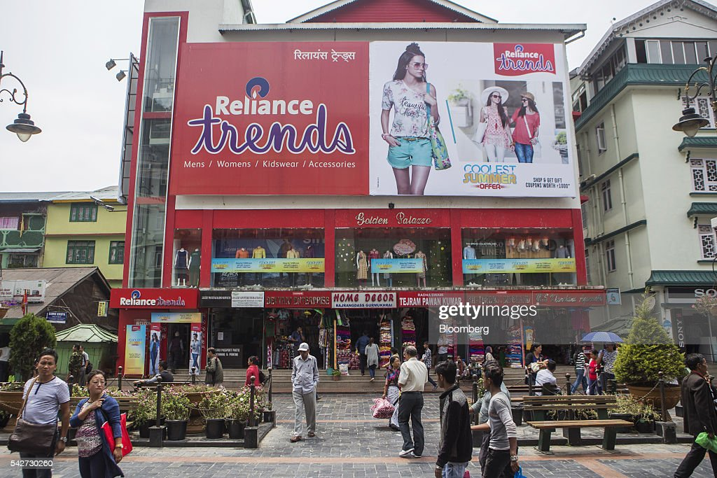 People walk near a retail outlet on Mahatma Gandhi Road in Gangtok, India, on Tuesday, May 3, 2016. Year-on-year growth in Asia's third-largest economy accelerated in the first three months of 2016 to 7.9 percent. Photographer: Prashanth Vishwanathan/Bloomberg via Getty Images