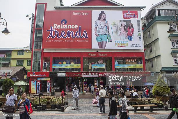 People walk near a retail outlet on Mahatma Gandhi Road in Gangtok India on Tuesday May 3 2016 Yearonyear growth in Asia's thirdlargest economy...