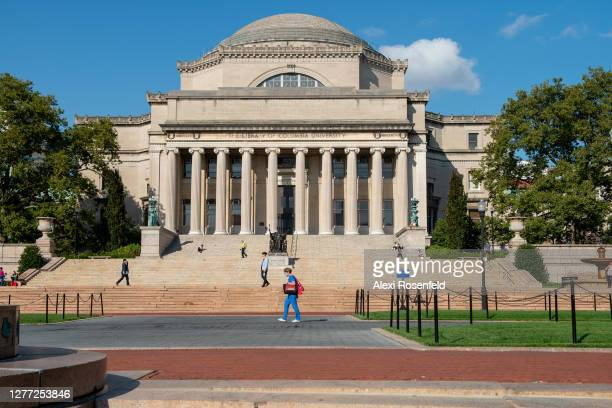 People walk near the Alma Mater statue at Columbia University as the city continues Phase 4 of re-opening following restrictions imposed to slow the...