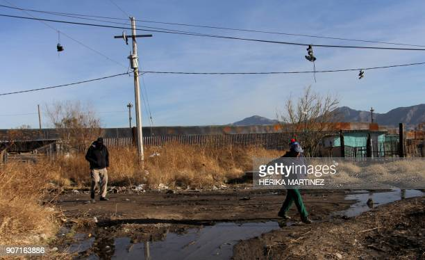 People walk near the border wall that divides Mexico from the United States in Ciudad Juarez Chihuahua state Mexico on January 19 2018 The Mexican...