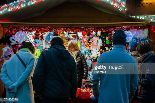 People walk near the Christmas Market in Brussels Belgium on December 22 2018