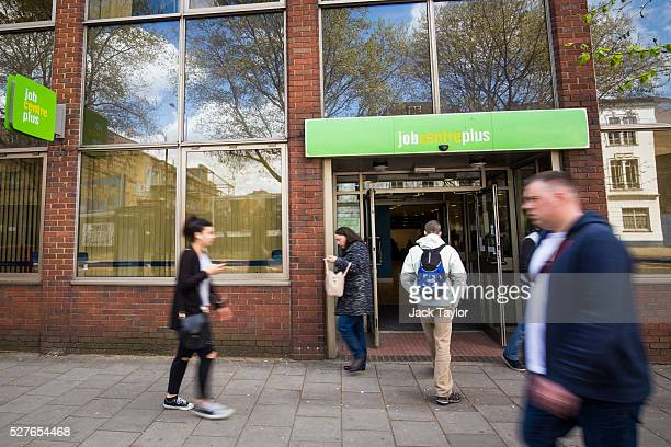 People walk near the Job Centre in Westminster on May 3 2016 in London England The Resolution Foundation chaired by former Conservative Minister...