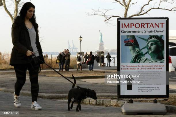 People walk near the Liberty State ferry terminal at Battery Park on January 21 2018 in New York City The iconic landmark remains closed as part of...