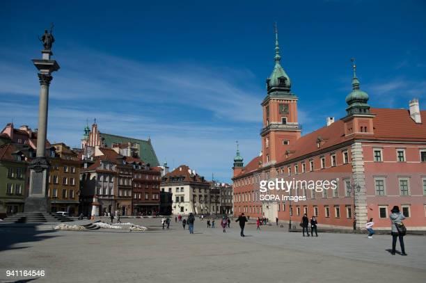 People walk near the Royal Castle in Warsaw