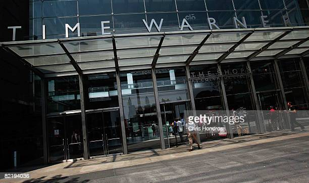 People walk near the Time Warner Center August 6 2008 in New York City Time Warner announced a second quarter profit drop of 26 percent on lower...