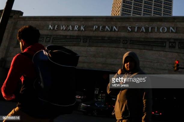 People walk next to Newark Penn Station on January 18 2018 in Newark New Jersey Amazon has released a shortlist for its muchanticipated second...