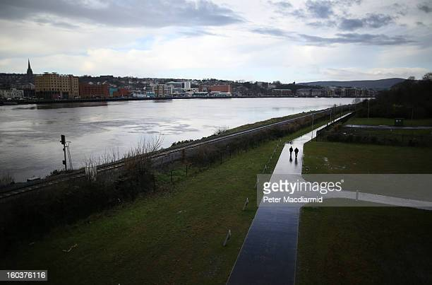 People walk next to the River Foyle on the Protestant side of the city on January 30, 2013 in Londonderry, Northern Ireland. A year of events have...