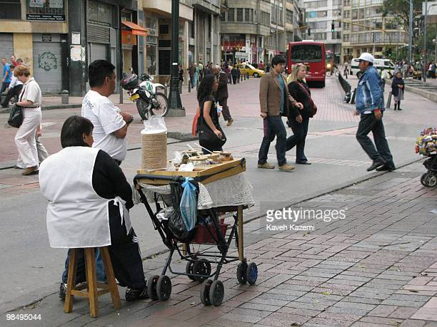 People walk on a busy street in Bogota Bogota formerly called Santa Fe de Bogota is the capital city of Colombia as well as the most populous city in...