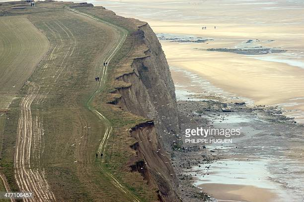 People walk on a coast path at the BlancNez cape near Sangatte northern France on March 7 2014 AFP PHOTO / PHILIPPE HUGUEN