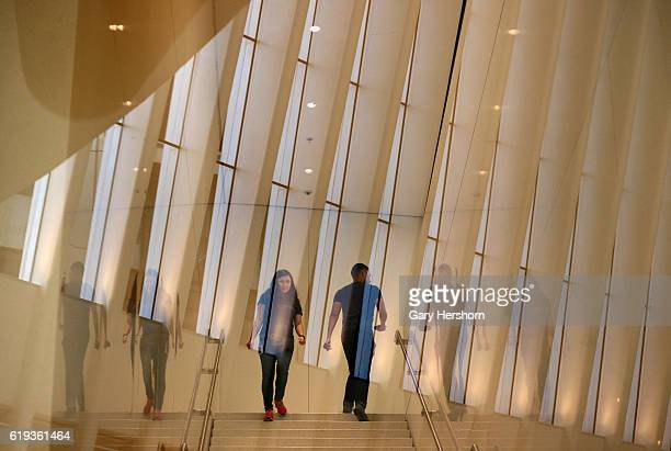 People walk on a staircase in the Apple store in the Oculus Transit Hub on October 28 2016 in New York City