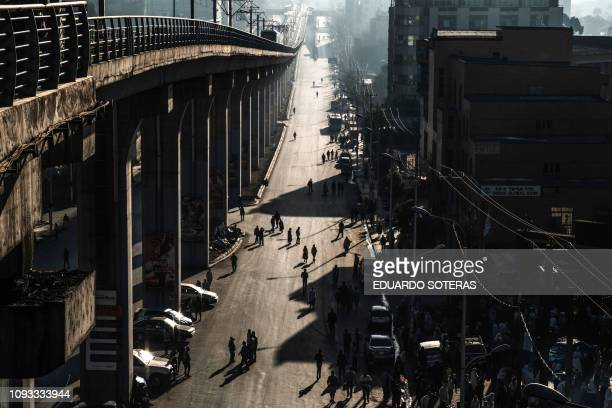 TOPSHOT People walk on a street in Addis Ababaon February 3 2019 during the third Car Free Day promoted by local NGOs and the Ethiopian Government to...