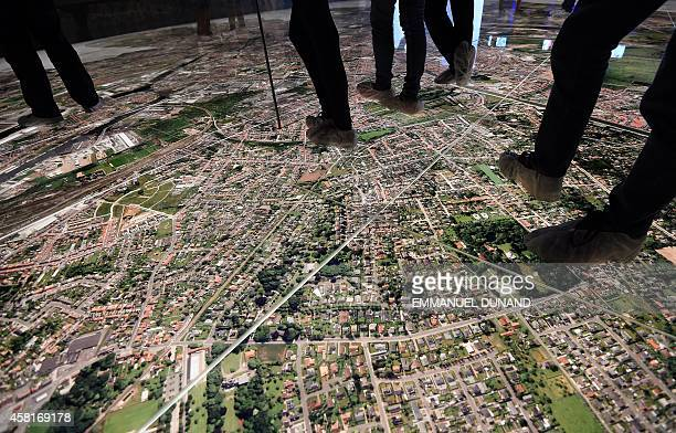 People walk on an aerial map of modern Bruges at the Stam Museum on October 30 2014 Bruges is the capital and largest city of the province of West...